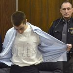 Ohio school shooter gets life, wears KILLER shirt and gives victims' families middle finger