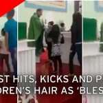 Unorthodox way of giving blessings to children by a priest!